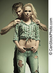 man holding with hands on woman's shoulders