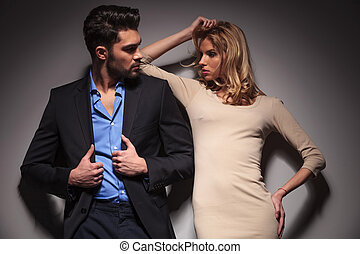 Young fashion couple looking at each other