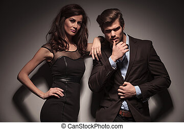 fashion couple looking into the camera