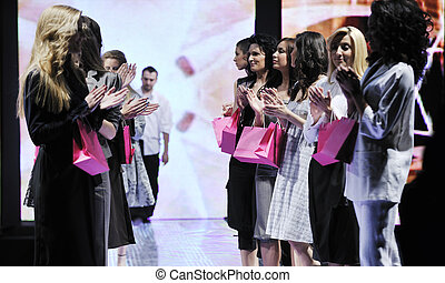 young fashion designer on the stage - young successful...