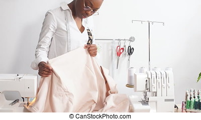 Young fashion designer working atelier. - Young fashion...
