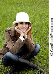 Young fashion girl in white hat