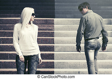 Young fashion man and woman flirting in a city street