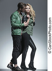 young fashion man holding his girlfriend