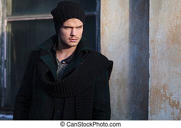 young fashion man looks away