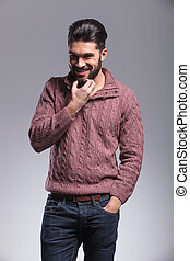young fashion man scratching his beard - Portrait of a young...