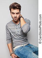 fashion man sitting on a stool