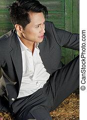 Young Fashion Man Sitting