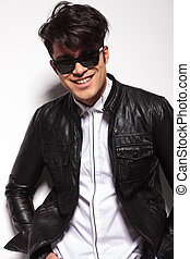 fashion man smiling to the camera - Young fashion man...