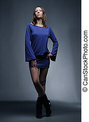 Young fashion model in blue