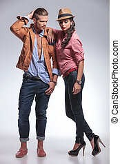 Young fashion woman leaning on her boyfriend