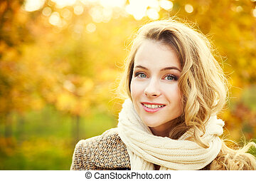 Young Fashion Woman on Autumn Background