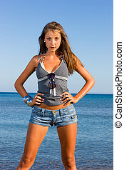 Young fashion woman on the beach