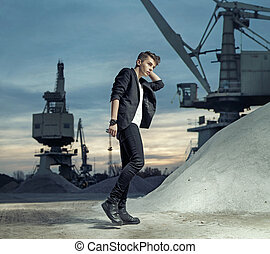 Young fashionable man on the builidng site