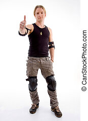 young fashionable man showing thumbs up