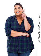 young fat woman looking and pointing up - young woman...
