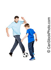 Young father and son playing soccer isolated on white