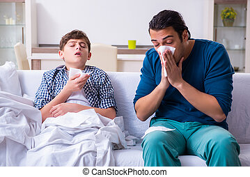 Young father caring for sick son