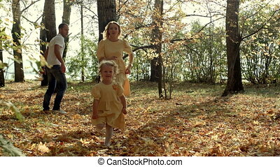 Young father for a walk in a autumn park with baby