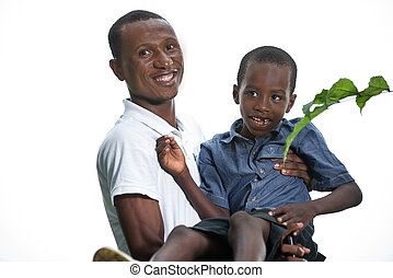 Young father playing with his son in his arms
