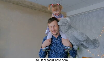 Young father spinning his happy daughter