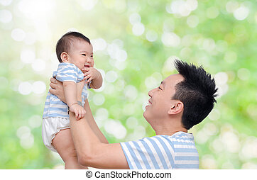 Young father with his child in garden