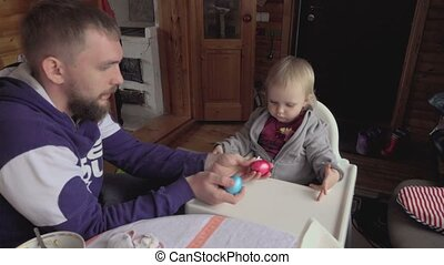 Young father with his daughter Easter breakfast