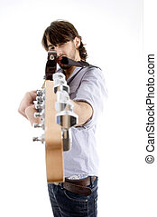 young fellow holding guitar like gun on an isolated white background