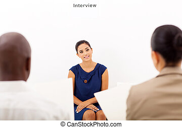 job interview - young female applicant during job interview