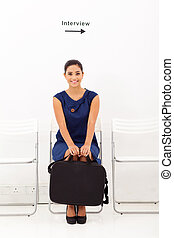 applicant waiting for job interview - young female applicant...
