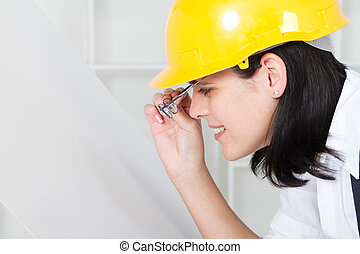 female architect looking at blue pr