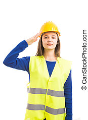 Young female architect making army salute