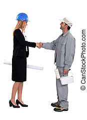young female architect shaking hands with painter