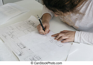 Young female architect working on sketches