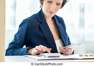 Young female bank officer at work