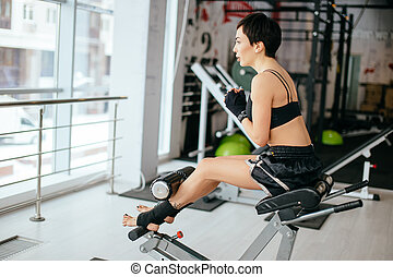 fat girl doing sit ups at sport center side view shot