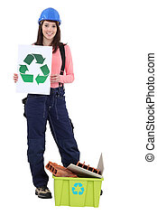 young female bricklayer all smiles holding recycling logo