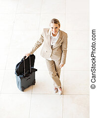 young female business traveler portrait