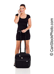young female business traveler talking on cell phone