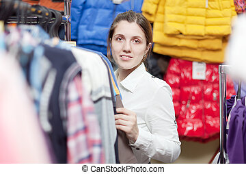 female buyer at clothing shop