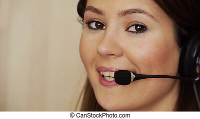 Young female call centre agent - Young woman at call using...