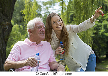 Young female carer with senior man