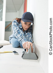 young female carpet fitter