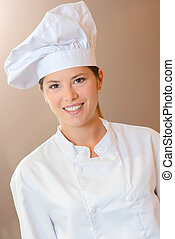 Young female chef in her uniform