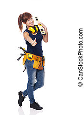 Young female construction worker showing OK sign