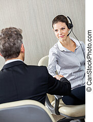 Young Female Customer Service Agent Shaking Hands With Manager