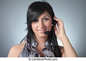 Young female customer service representative in headset.