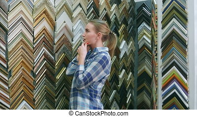 Young female customer talking about picture frame details...