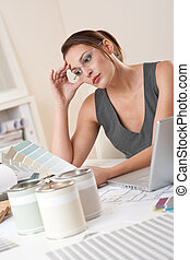 Young female designer working at office with laptop