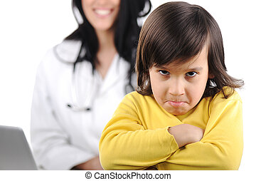 Young female doctor examining little cute angry child refusing examining